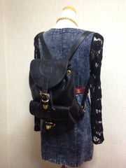 Vintage Gianni Versace black leather backpack with a big embossed medusa with gold tone hardware. Unisex bag for daily use.