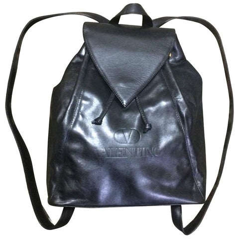 Vintage Valentino black nappa leather backpack with embossed logo. Classic masterpiece.