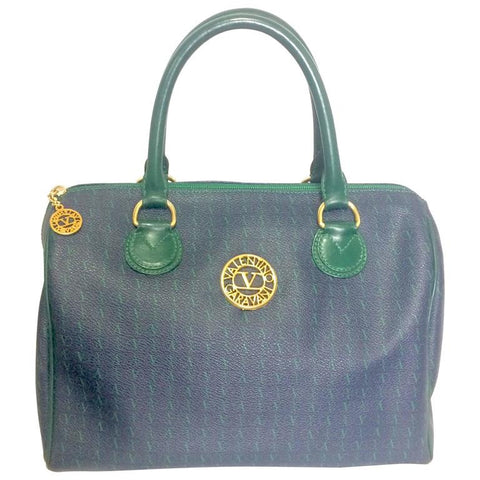 Vintage Valentino Garavani blue and green speedy bag style handbag with golden logo cutout motifs. Valentino mini duffle purse for daily use.