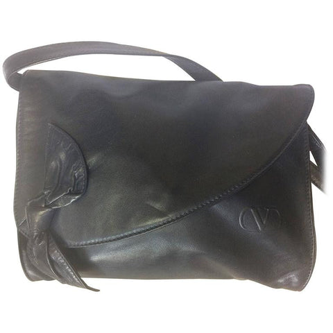 Vintage Valentino Garavani, Black nappa leather clutch purse, shoulder bag with tied bow, ribbon and V logo motif at front.