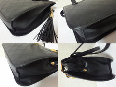Vintage Gianni Versace black leather tote bag with a tassel and golden sunburst charms. Lady Gaga style