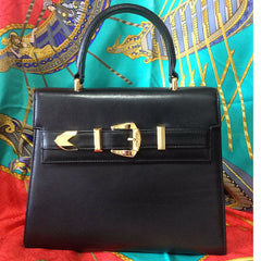 Vintage Gianni Versace black leather Kelly style bag with golden buckle closure and shoulders strap. Gorgeous masterpiece