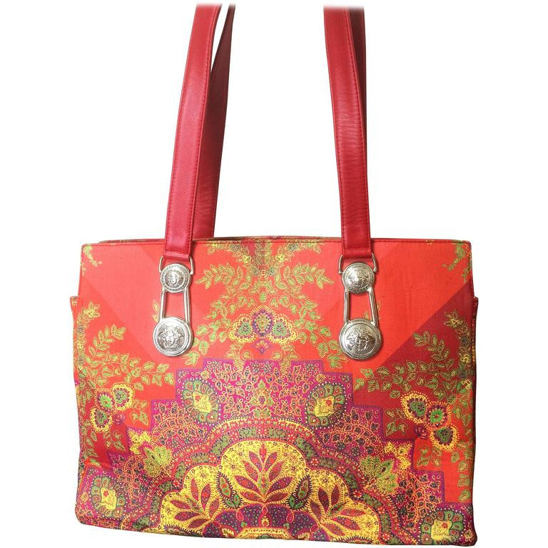 Vintage Gianni Versace gorgeous red orange and multi color ethnic and flower design shoulder, tote bag with silver medusa motifs. Lady Gaga