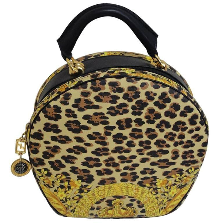 MINT. Vintage Gianni Versace leopard and gorgeous print vanity bag in round shape with black leather shoulder strap. Lady Gaga Style