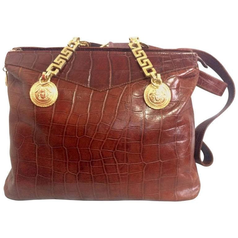 Vintage Gianni Versace brown croc-embossed leather shoulder tote bag with golden hardware and medusa charms.