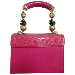 Vintage Gianni Versace pink calf leather and genuine snakeskin handbag with golden and black balls handles.