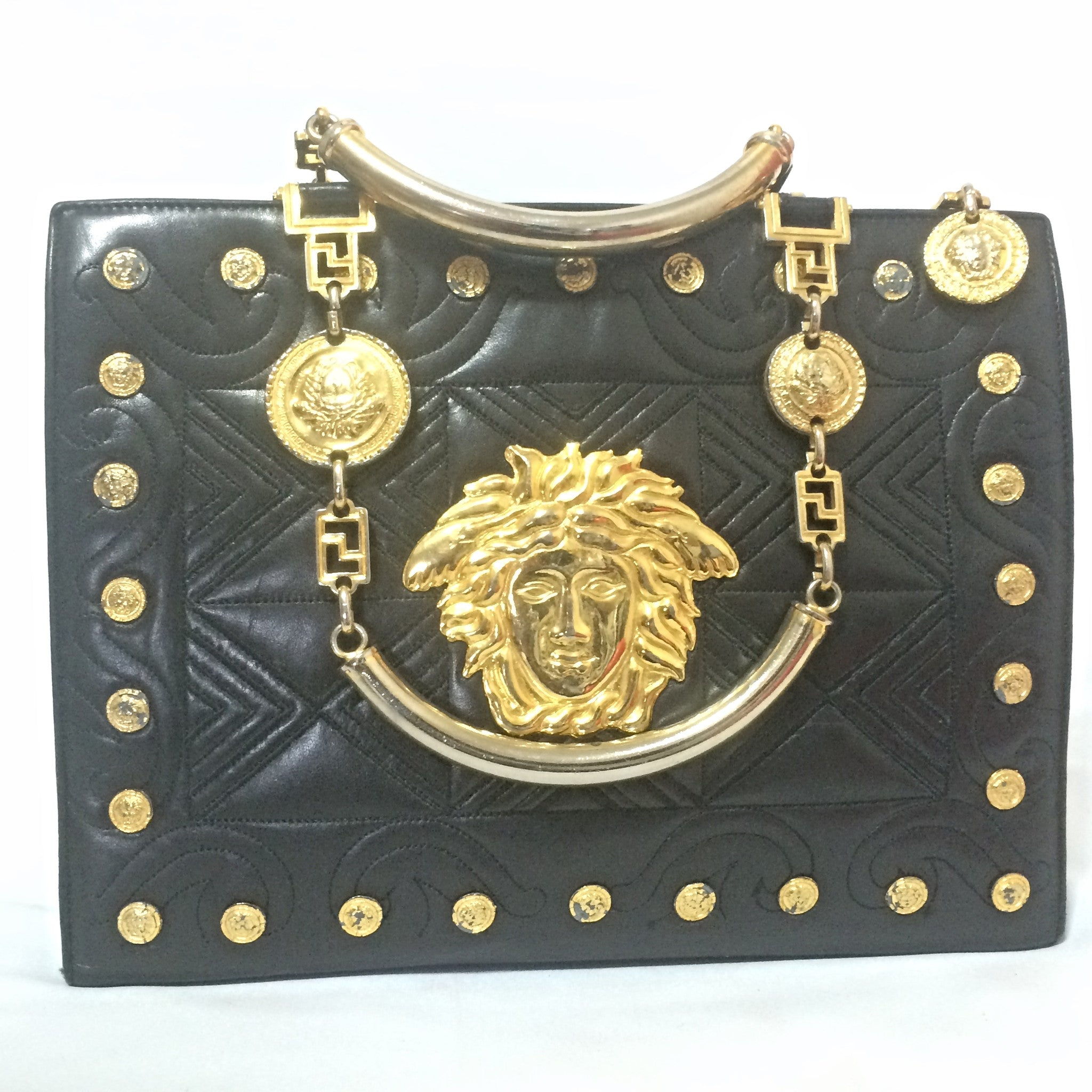 Vintage Gianni Versace black leather tote bag with big golden medusa charms, and gold tone hardwares. Too Gorgeous like Lady Gaga.