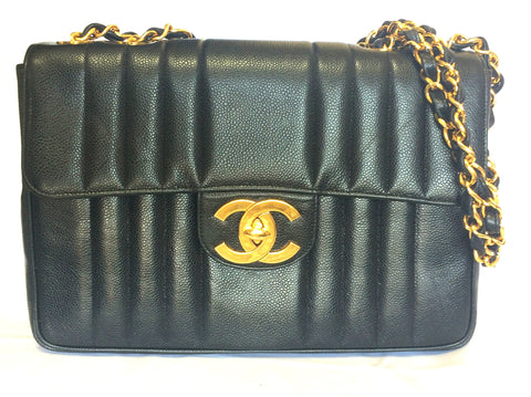 4ed9c1bc4c18 Vintage CHANEL black 2.55 jumbo caviar leather large shoulder bag with  golden CC Vertical stitch.