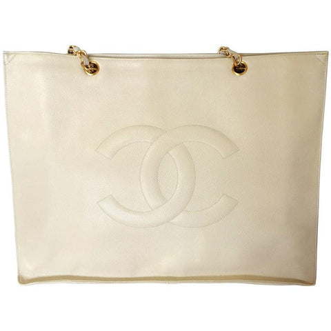 Vintage CHANEL ivory white color caviarskin large tote bag, shopper with gold-tone chains and large CC stitch mark. Perfect daily bag.