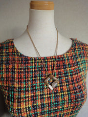 MINT. Vintage Yves Saint Laurent, YSL skinny chain necklace with outlined square pendant top with crystal stones.