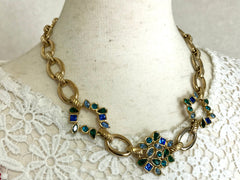Vintage Yves Saint Laurent, YSL golden chain necklace with blue and green stones.