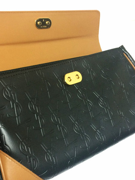 403391c740c6 ... Vintage Yves Saint Laurent YSL logo embossed black leather handbag purse  with brown leather trimmings and ...