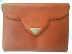 Vintage Yves Saint Laurent genuine brown leather clutch purse with beak tip flap and triangle embossed logo motif. Classic YSL bag.