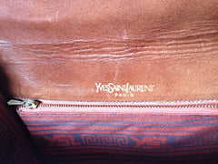 Vintage Yves Saint Laurent genuine brown leather mini document bag, clutch purse with embossed logo. Classic unisex style YSL purse