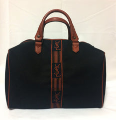 Vintage Yves Saint Laurent black canvas duffle handbag, mini travel bag with brown trimmings and YSL logo. Unisex purse for daily use.