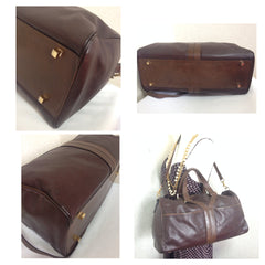 70's, 80's vintage Yves Saint Laurent genuine dark brown leather travel and daily use duffle bag. Classic unisex style YSL purse