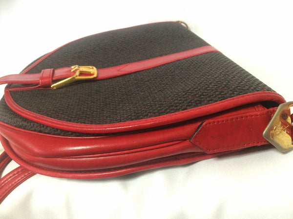 625ea043ec Perfect daily Vintage Yves Saint Laurent oval navy shoulder bag with red  leather shoulder strap.