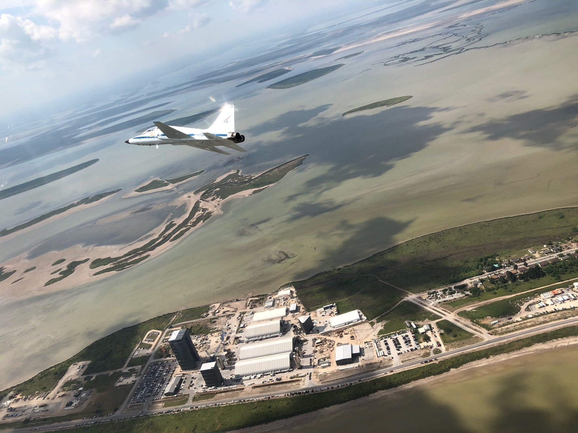 NASA Astronauts fly over SpaceX's Starship facility in South Texas
