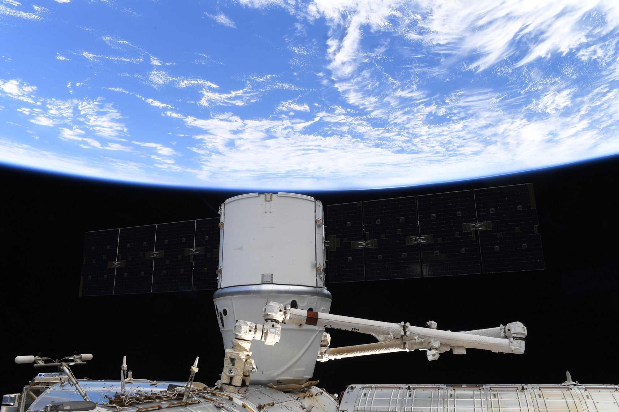 SpaceX Dragon docked to the Space Station today -Expedition 62 NASA Astronauts will unload the cargo