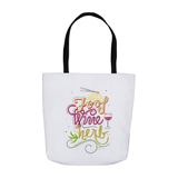 "Image features a sturdy white tote with a black handle. The tote is hand lettered and illustrated with the phrase ""Food. Wine. Herb."" and features illustrated noodles, a glass of wine and a cannabis leaf."