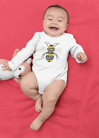 "Baby wearing 100% cotton white onesie that reads, ""Don't Call Me Honey, Call Me Boss."" in yellow and black hand lettered illustration style."