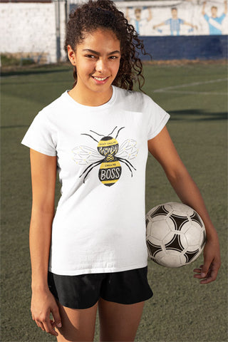"Teen girl holding a soccer ball wearing a white cotton T-shirt that is hand lettered and illustrated with the phrase ""Don't Call Me Honey, Call Me Boss."""