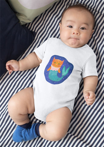 cute baby wearing white short sleeved onesie with illustration of orange purrmaid (mermaid cat) with a green fit floating in space.