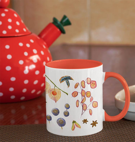 White accent mug with orange accent handle, illustrated with botanical seed pods. Gifts for women, gift for nature lovers.