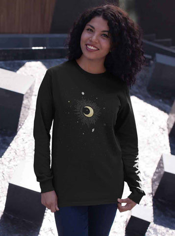This soft Bella & Canvas long sleeved black T-Shirt features an illustration of the crescent moon in the center, surrounded by stars, Jupiter, Saturn, Mercury and Pluto. The constellation is Capricorn.