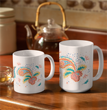 Two white mugs, 11 oz and 15 oz, are sitting side by side. Each features digital illustrations of intricate paisley patterns.