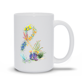 Desert Flower Amper-Sand Mug features an ampersand symbol created from flowers of the desert: desert marigold, globe mallow, indigo bush, old man sage, red yucca, ocotillos, purple mat, rainbow cactus.