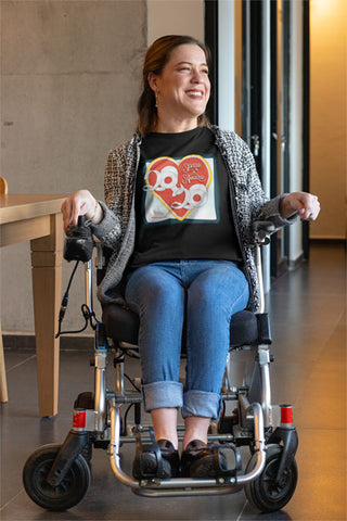"Woman  in wheelchair wearing a graphically designed T-Shirt that says ""Spare a Square 