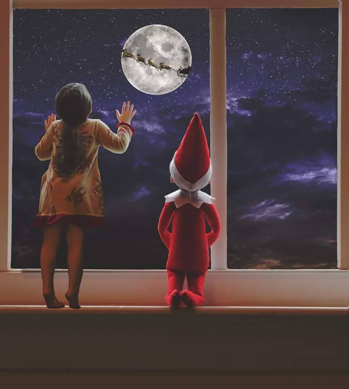 young girl and her elf on the shelf looking out the window with night sky overlay