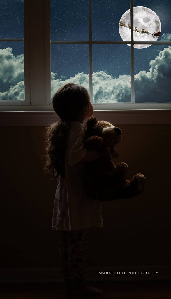young girl looking out the window at moon, clouds and santas sleigh