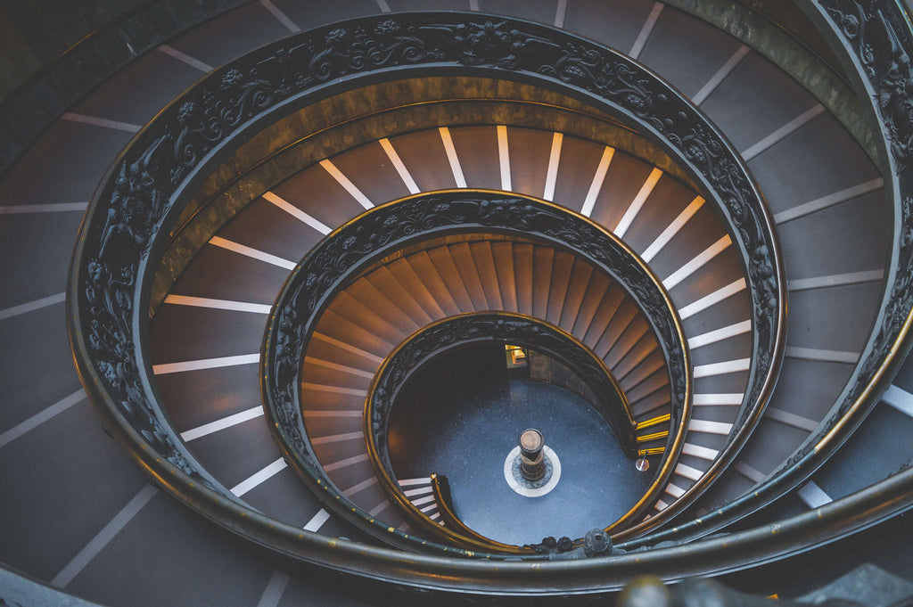 Downward Perspective Photo of Spiral Staircase
