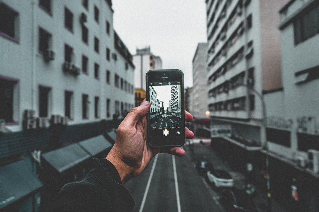 Perspective Photos - Image of a Smartphone Taking a Photo of City Buildings