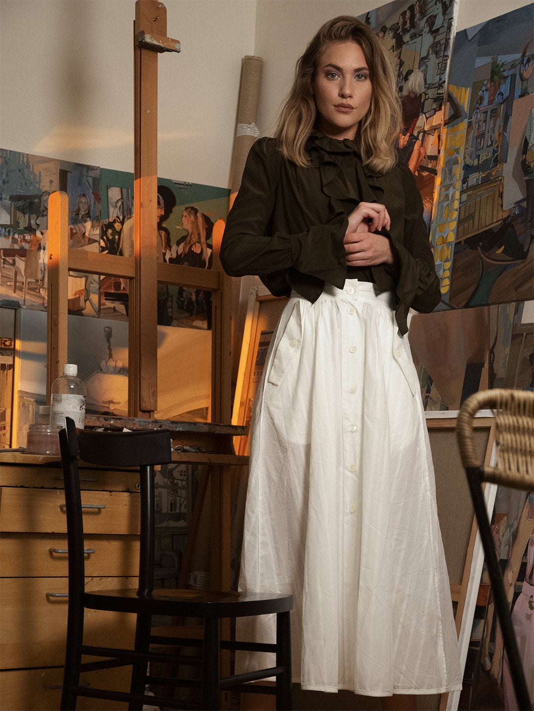 Alice Herbst wearing Anima blouse and Laura skirt
