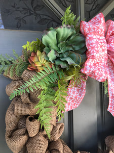 Burlap wreath with artificial succulents and ferns