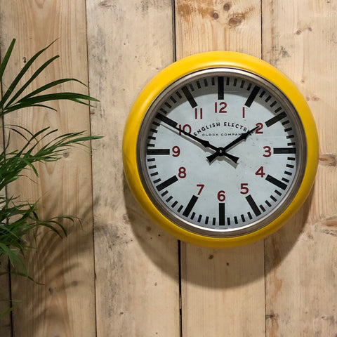 Round Yellow Metropolitan Distressed Metal Wall Clock