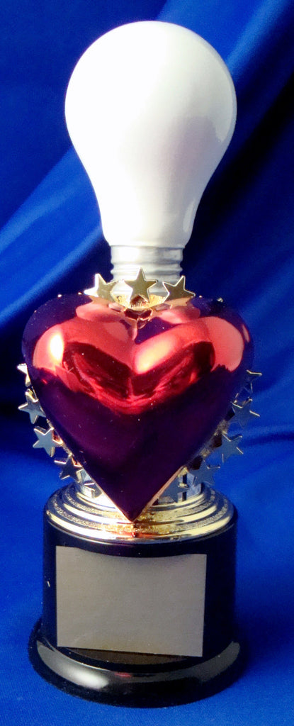 White Light Bulb On Black Round Base With Heart
