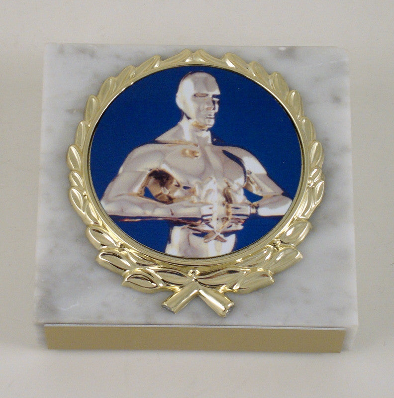 Achievement Paperweight on White Marble