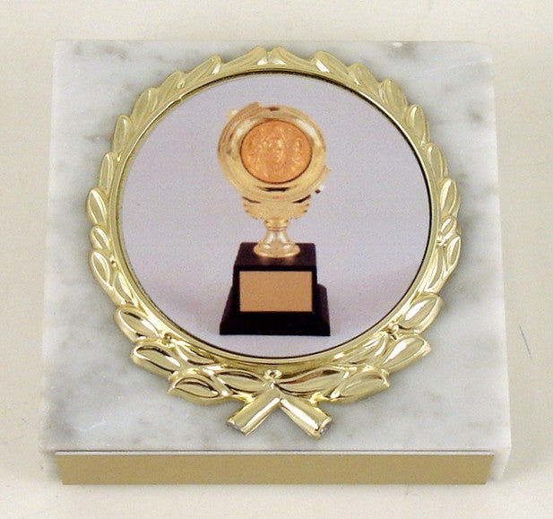 Toni Award Paperweight on White Marble