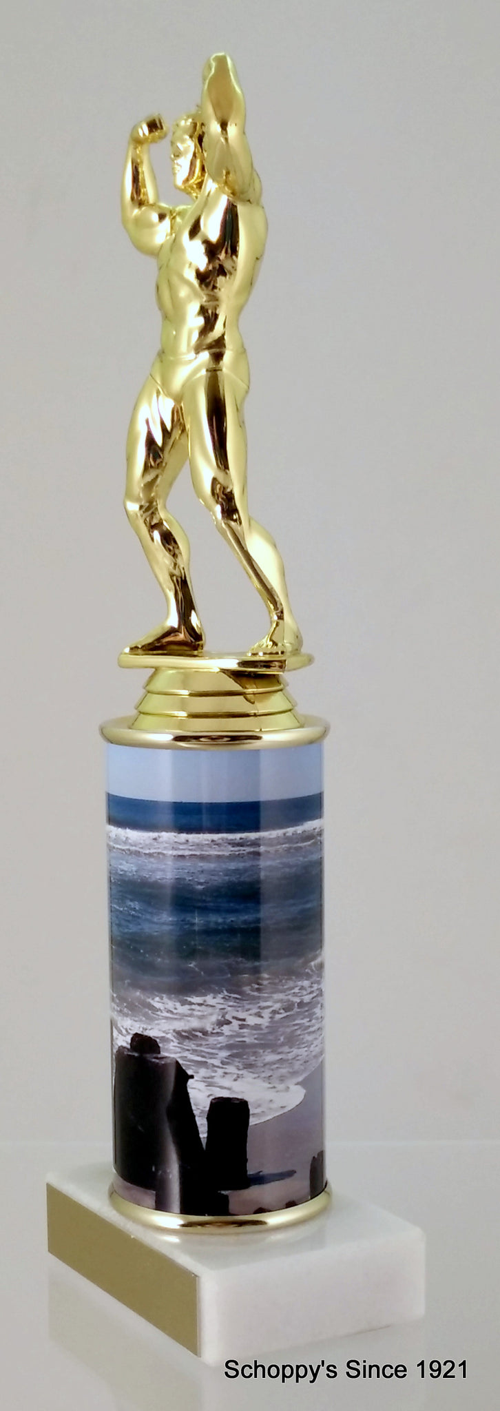 Body Builder Trophy With Beach Metal Column On Marble