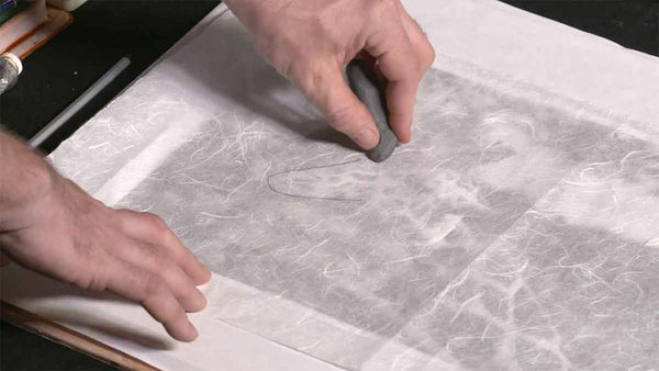 How to carefully remove graphite pencil line from delicate watercolor paper