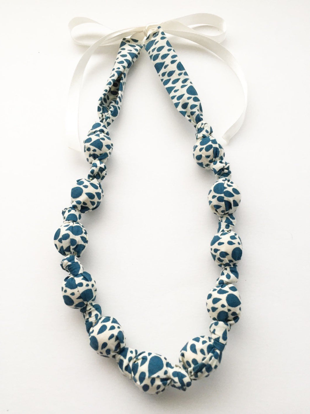 Organic Raindrops in Navy Fabric Teething Nursing Necklace by Wee Kings