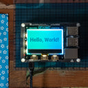 A product image of GFX HAT - 128x64 LCD Display with RGB Backlight and Touch Buttons