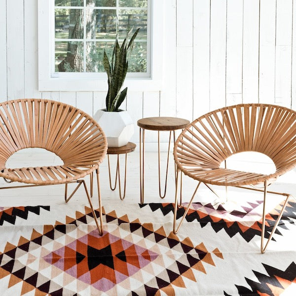 LEATHER STRAP CHAIRS AND AZTEC RUG