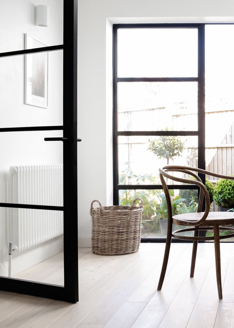 DYKE & DEAN | BLACK GLASS CRITTLE DOORS AND BENT WOOD ARM CHAIR