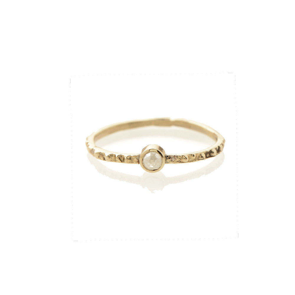 Gold single rough diamond urch band