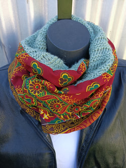 Knitted scarf with a touch of African print.
